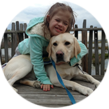 little girl with yellow service dog