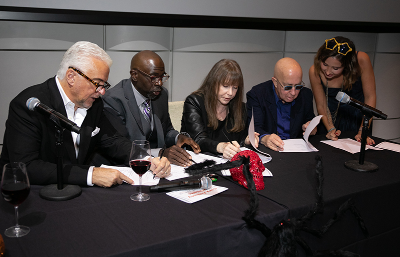 Celebrity judges collaborating while sitting at a table