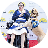 woman in wheelchair with Canine Companions service dog